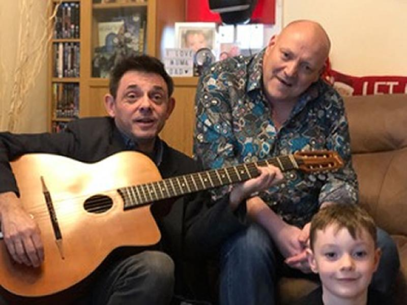 World Cancer Day: Prog Rock Legend signs guitar for charity fundraiser