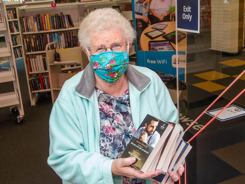 Kilbarchan resident Ann Clark is first through the door as libraries reopen!