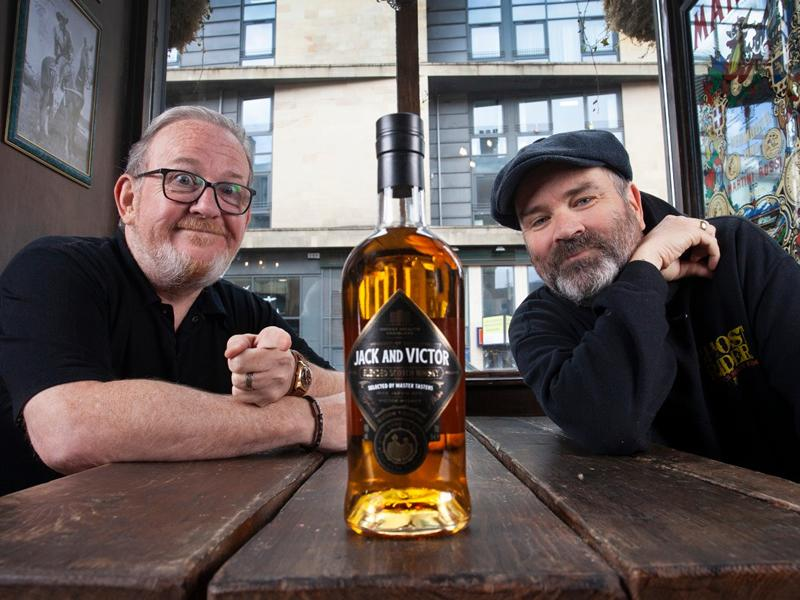 Jack and Victor raise a glass as whisky goes live